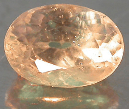 Natural Alexandrite under incandescent light